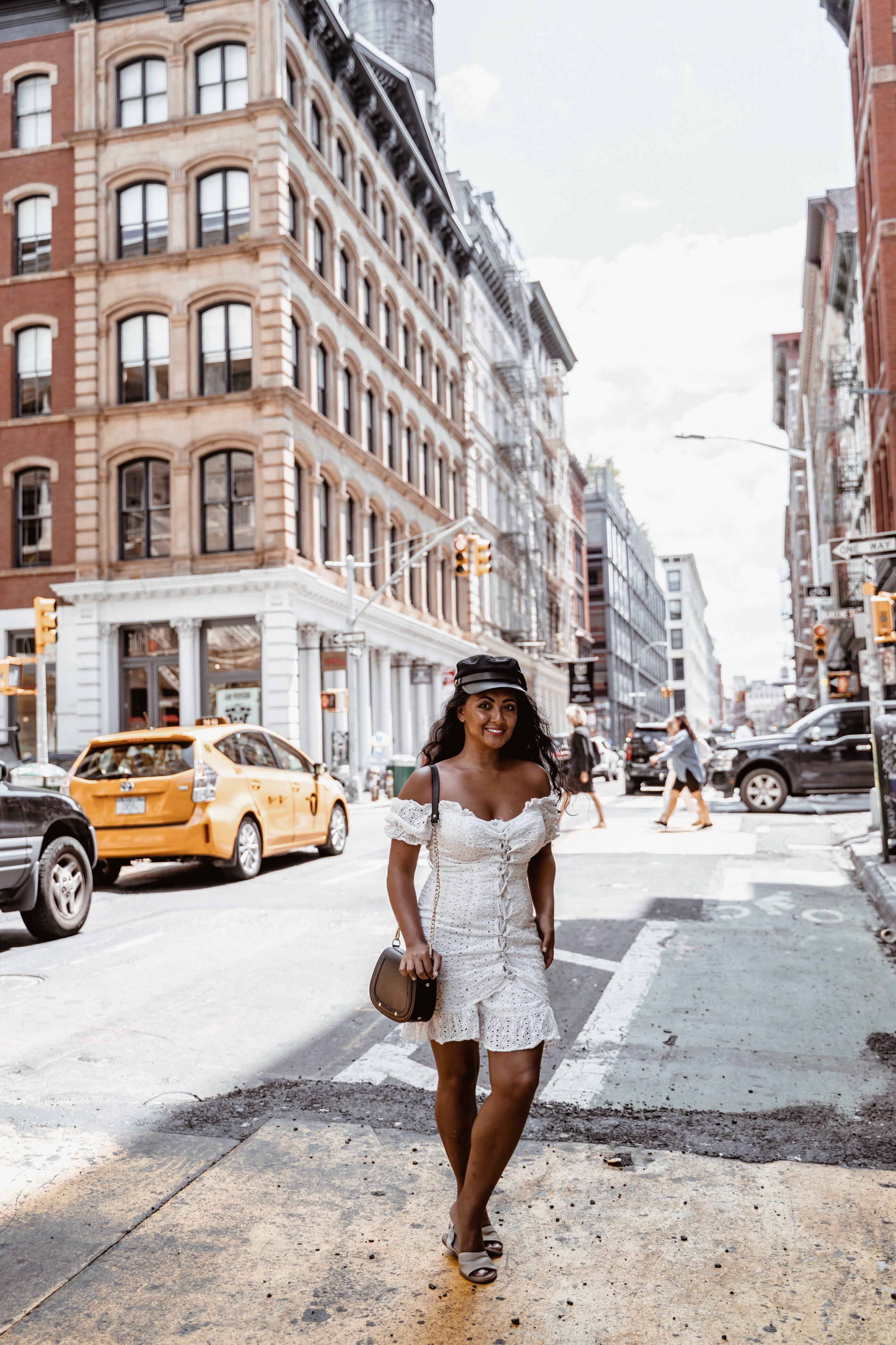 Marjolyn Lago Marj what to wear in new york city paris chic style off the shoulder white dress
